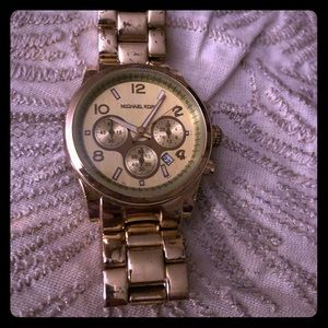 Authentic Michael Kors Gold watch works perfect!